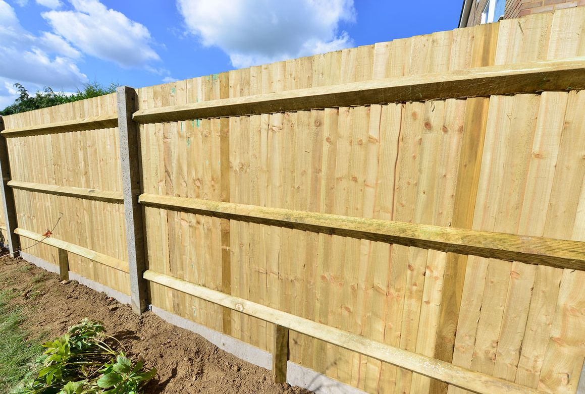 Newly installed Feather Edge Panels fence
